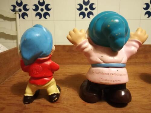 Retro dei nani , entrambi Walt Disney , uno prodotto da  Ledra Plastic e l'altro Made in Korea